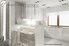 Projekt kuchni Inventive Interiors - jasna kuchnia w bieli i beżu