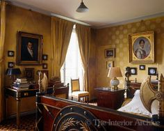 golden wallpaper in bedroom in Chateau Groussay