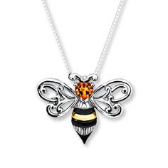 Crafted in sterling silver with 10K yellow gold stripes, this bumble bee glows with a sunny heart-shaped citrine head. The pendant is suspended from an 18-inch sterling silver box chain with a lobster clasp.