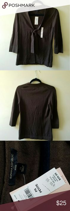 New w/ Tags Banana Republic Sweater This is a never been worn item with the tags still attached! The detailed bow in the front of the sweater is super cute. This sweater if perfect for work or for a casual day doing errands. Banana Republic Sweaters