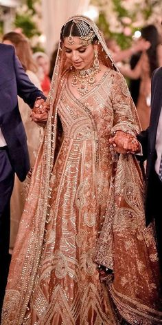 30 Exciting Indian Wedding Dresses That You'll Love ❤ indian wedding dresses lehenga colored oshoot Indian wedding dresses are very beautiful. Usual indian bridal dresses made of chiffon or silk and adorned with elaborate embroidery, red or gold color. Asian Bridal Dresses, Asian Wedding Dress, Pakistani Wedding Outfits, Indian Bridal Outfits, Bridal Lehenga Choli, Pakistani Bridal Dresses, Pakistani Wedding Dresses, Indian Bridal Wear, Indian Dresses