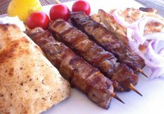 Pork Souvlaki (Skewers) with Tzatziki Sauce... The taste of its secret marinade will instantly transport you back to your favourite taverna