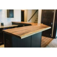 Add a unique touch to your counter space with this Hardwood Reflections Butcher Block Countertop in Solid Wood Oiled Acacia.