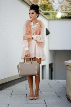 Love this look for fall. Delicate dress & fur vest