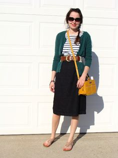 green cardigan, striped top, belted.