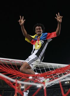 Juan Cuadrado of Juventus FC celebrates after winning the TIM Cup final match against AC Milan at Stadio Olimpico on May 21, 2016 in Rome, Italy.