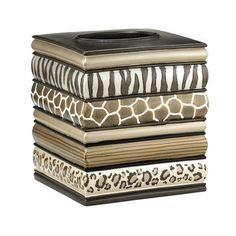 Features:  -Safari Stripe collection.  -Material: Resin.  -Wipe clean with dry cloth.  -Do not submerge or use harsh soap to clean.  Product Type: -Tissue box cover.  Finish: -Chocolate.  Primary Mate