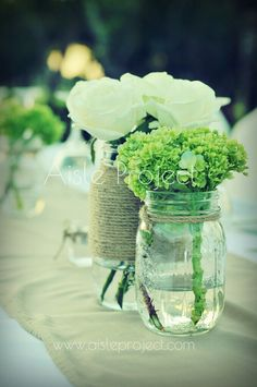 Wedding decoration bali wedding vintage centerpiece for guest simple bridal table centerpiece white roses and green hydrangea in stagioni jar tied with junglespirit Choice Image