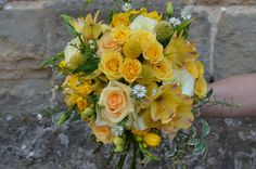 pretty, country styled bouquet in yellows and white