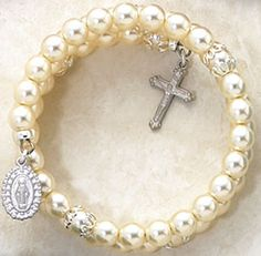 5 Decade Wrap Bracelet with Pearl Beads - Wear your devotion to God and His mother wherever you go with our 5 Decade Wrap Around Bracelets. This bracelet features 6mm faux semi precious pearls with silver medal and crucifix.   $29.99