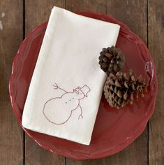 A napkin embellished with a snowy buddy can be used all winter long.