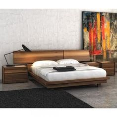 Sleek european platform bed made with walnut and available with glass tops