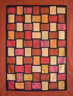 """Weave""  by Carol A Ashley, AllThatPatchwork, via Flickr.  What could be an easier quilt to make than one in which the blocks are of three straight pieces?  I created this quilt top as a quick charity project."