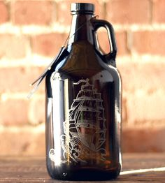 This etched glass growler is the perfect marriage of two of our favorite activities: drankin' beers and exploring the high seas. The engraved design features an old-timey ship riding the waves, and the etching stands out against the deep amber glass. It's packaged with a fabric pouch for storage and an extra-large coaster to protect surfaces from giant rings. Be the envy of other homebrewers when you share your latest batch, or surprise your favorite drinking buddy, groomsman or homebrewer.