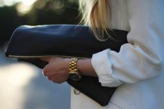 Oversized clutch and Gold watch. LOVE.