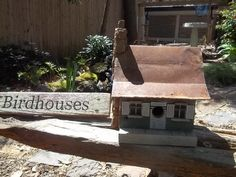 This one has a rusty tin roof and peanut stone chinmey.