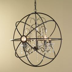 Crystal and Metal Orb Chandelier Delicate dangling glass crystals add a luxurious counterpoint to this bronze iron sphere chandelier