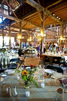 We love the rustic ambiance of April and Claire's #barn #wedding. #rustic    Photo: Anne Skidmore Photography