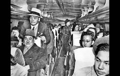 Japanese Americans ride on a bus to Mansanar internment camp... One of the many shameful parts of American history