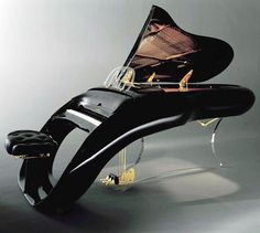 £70k or $117,000 musical instrument is more than black shiny furniture in a modern apartment! Ergonomic curved computer keyboards might have inspired the unique design of Shimmel firm's Pegasus Grand Piano. RESEARCH -DdO:) - http://www.pinterest.com/DianaDeeOsborne/instruments-for-joy/ - At the heart is a cast-iron base plate, supporting 220 strings & 10,000+ components. Model name comes from electronically controlled lid having a gold figure of winged horse Pegasus. Flying design of flow.
