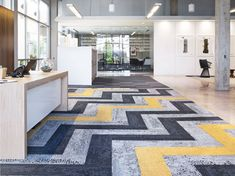 Interface Atlanta Showroom Herringbone area rug with Human Nature