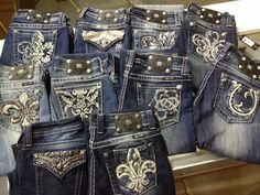 I would do anything to have all of these miss me jeans!!