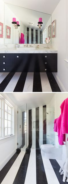 The black and white striped flooring in this bathroom travels from under the vanity, across the floor, and up into the wall of the shower.