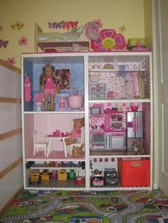 American Girl Sized Doll House in an Ikea bookshelf with a toy car garage on the bottom (for shared girl and boy room)
