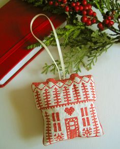 Hey, I found this really awesome Etsy listing at http://www.etsy.com/listing/150430350/swedish-house-embroidered-christmas Ornament