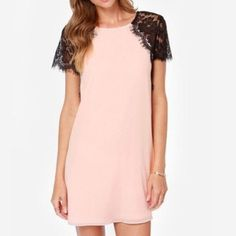 """NIP Lace Sleeve Dress New in package lace sleeve sheer dress. Black lace sleeves and blush pink dress with keyhole back. Measures from neckline to hem: 26"""". From armpit to hem: 19"""". From armpit to armpit (chest): 17.5"""" Blue Door Dresses Mini"""