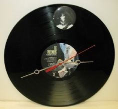 This clock is made from The Pretenders 1984 Learning to Crawl album. Quartz movement and requires 1 AA battery.   Our Price: $14.95  Availability: In Stock