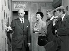 Otto Frank shows Anne Frank's room to the playwrights.  Otto Frank in Anne's and Fritz Pfeffers's room with the makers of the Broadway play 'The Diary of Anne Frank', Frances Goodrich and Albert Hackett, and with director Garson Kanin.