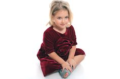Beautiful red velvet dress with flower draping from Designers for Kids. On www.designersforkids.ro you may find children clothes inspired from fairytales and suitable for modern princess.
