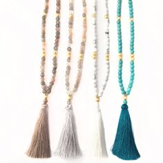 A beaded boho tassel necklace in the color of your choice on gold dipped chain. Necklace length is 30. Available options from left to