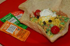 April Fool's Taco Tuesday (4/1/14 is a Tuesday!) - fake Taco salad The meat is choc. ice cream with cake scraps for texture.  Coconut dyed for the cheese and lettuce; maraschino cherries for the tomatoes; Cool Whip for the sour cream; and a real flour tortilla formed and baked then sprinkled with cinnamon/sugar on the inside.  Oh, we really are having taco salads for dinner.  Hey, why not have dessert first! ...