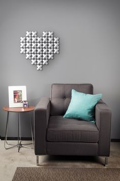 cross stitch WALL DECOR | Allows you to stencil 40 molded 'stitches' into a multitude of characters and shapes to create warm messages and mementos on your wall. DESIGN by Marianne van Ooij/Joel Yatscoff // UMBRA (C) 2012