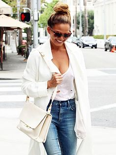 Chrissy Teigen white T-shirt, jeans and a white trench coat in LA | allure.com