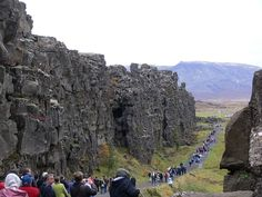 Tectonic plates grow at spreading centers. This one passes right through Iceland and is the only place on Earth where you can see it. Id love to see it, and will someday. beautiful-geology