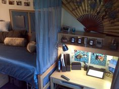 Dorm room idea. I like that (through the link) the dresser is behind the door when it opens. Kinda like a changing area. Plus even with people over and the door open, nobody would see the piles of clothes you swore you wouldn't make in your dorm room 0:-)