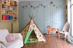 Teepee with vintage Cowboys and Indians pattern for a little boys room.