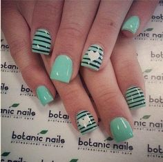 Black Stripes with White Hearts on Green Nails