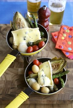 Raclette of Blue Brie with Baby Potatoes, Cornichons, Onions and Warm Grape Tomatoes.