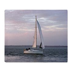 Yacht at sunset, Isle of Wight Throw Blanket on CafePress.com