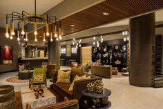 This #lobby design engages everyone that walks in the space with its rich #earthtones, #naturalwood and stone finishes, interesting #textures, and comfortable furnishings that are simultaneously #modern and #transitional