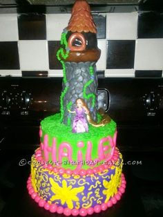 Coolest Rapunzel Tower Cake... This website is the Pinterest of birthday cake ideas