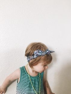 Little babe, ella, in the perfect summer floral knotted headband for little girls, newborns and toddlers looking for hair accessories. @Zoey & Logan | Baby & Kid's Fashion - handmade with a soft fabric that stretches comfortably around your babies head and looks absolutely gorgeous on all baby girls. 3 months - toddler *The headband top knot is adjustable so that you can tighten and loosen as your child's head grows.