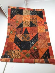 Jack-O-Lantern mini quilt posted at Kindred Quilts