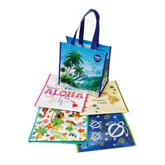 Hawaiian map bag for our welcome bag.  These are re-usable shopping bags from the ABC store.  Plus pink tissue (pineapple, Hawaiian craft beer x 2, local water, Hawaiian sea salt, local coconut candy, mac nuts, maps, sun block, postcard with stamp, pamphlets from our excursions, personalized golf bag tags, program of events, guest room and cell numbers).