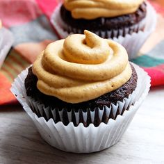Double Chocolate Cupcakes with Pumpkin Frosting- a cupcake with delicious moist cake and pumpkin spice frosting.