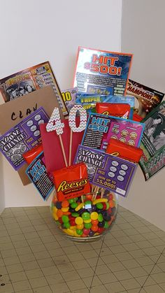 40th birthday bouquet for the Hubby. Candy, pb cups, gift card and scratch offs.